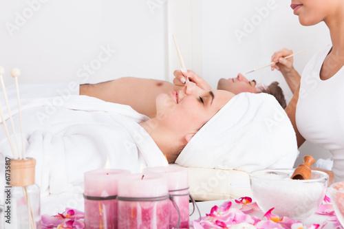Couple Applying Facial Mask