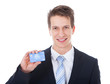 Happy Young Businessman Holding Credit Card