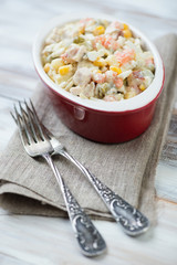Close-up of russian traditional olivier salad, vertical shot