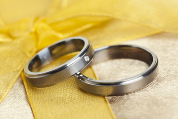 Wedding Rings on golden bow