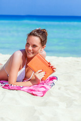 An young woman is relaxing on the beach