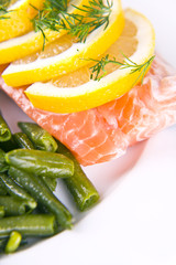 salmon with sliced asparagus and lemon sprinkled with spices