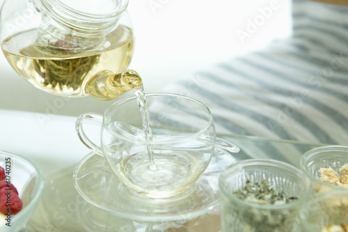 Woman pouring jasmine tea
