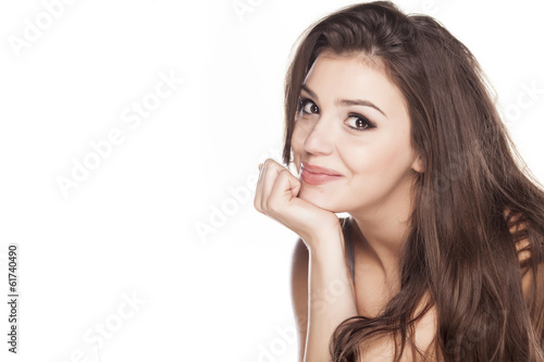 Smiling young woman on white background - 61740490