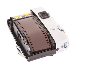 Old retro analog camera with new film roll over white background