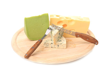 Various types of cheeses on wood. With knife.