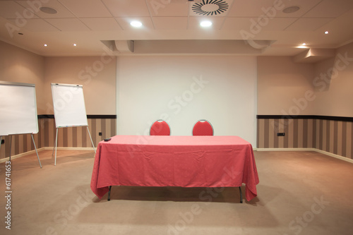 empty conference room with red table
