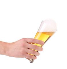Glass of beer with foam in hand.