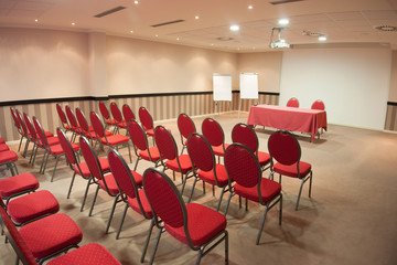 empty conference room with red chairs