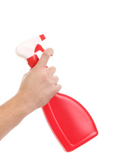 Hand holding red plastic spray bottle.