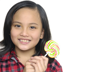 Close up smiling girl holding candy