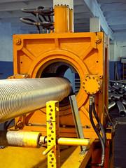 Metal corrugation forming machine.