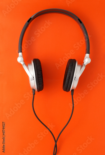 DJ headphones on orange background