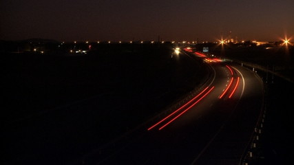 Highway cars at sunset time lapse
