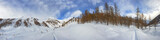 winter snow panorama on cloudy sky background