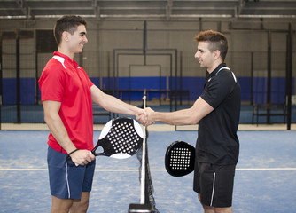 Paddle tennis hand shake