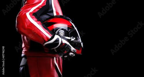 Fotobehang Extreme Sporten closeup of biker holding helmet side view