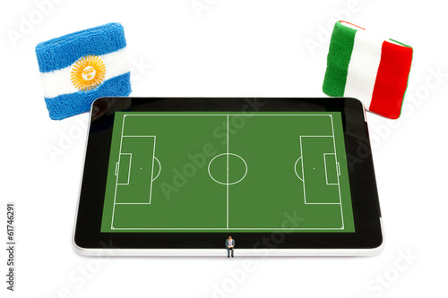 Man booking Soccer event on Digital Tablet - Argentina vs Italy