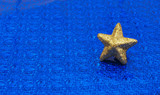 Gold star on  metallic blue background