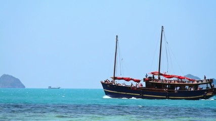 Small sea ship sailing with people onboard