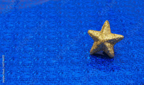 canvas print picture Gold star on  metallic blue background