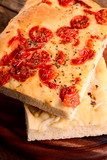italian focaccia with little tomatoes and with onions