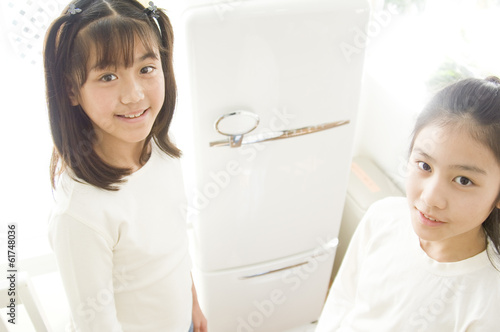 Two Japanese girls in front of refrigerator