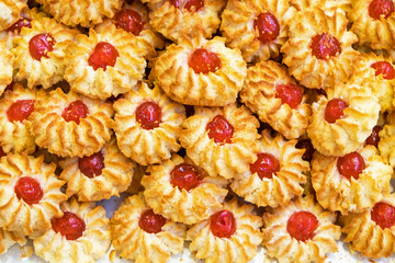Tasty Italian biscuits with a red cherry filling