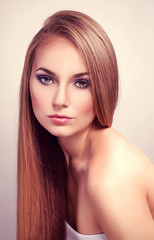 Pretty fashion  female model with long straight glossy hair
