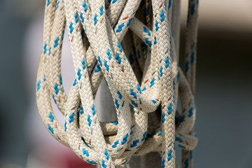 Ropes on classic sailboat - tackles on the yacht.