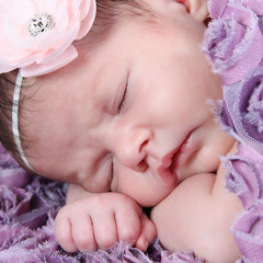 Sweet newborn baby girl sleeping