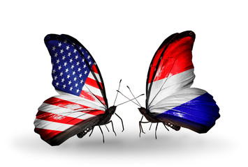 Two butterflies with flags USA and Netherlands