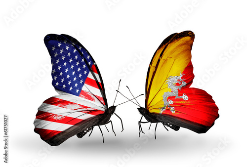 Two butterflies with flags USA and Bhutan