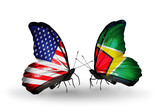 Two butterflies with flags USA and Guyana