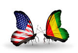 Two butterflies with flags USA and Guinea