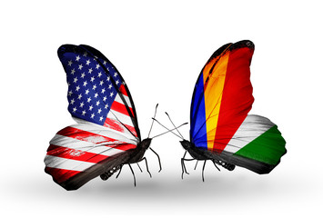 Two butterflies with flags USA and Seychelles