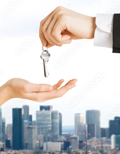 close up of man and woman with house keys