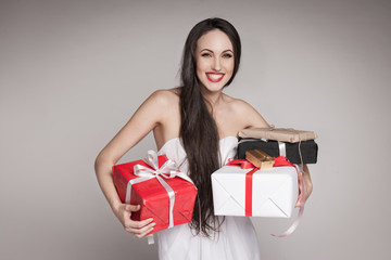 Smiling beautiful woman holding gifts