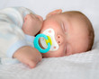 canvas print picture - Infant baby boy sleeping peacefully with pacifier
