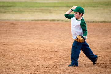 Boy throws baseball during practice