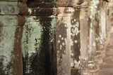 close up of ancient stone pillars at Angkor Wat