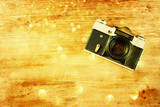 vintage old camera on brown wooden background
