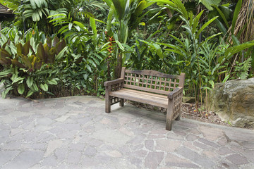 Wood Bench in Tropical Garden