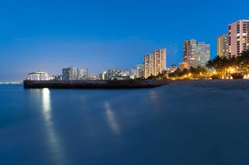 Beach at Waikiki with buildings and a Gazebo
