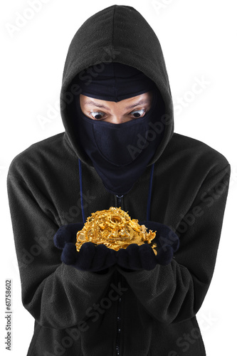 A thief holding stolen gold