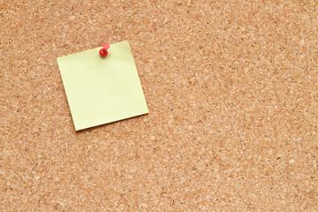 blank post it note on a cork board