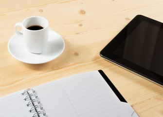 cup of coffee and tablet near notes, concept of new technology