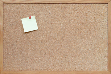cork board with post it note