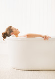 Young woman relaxing in bathtub
