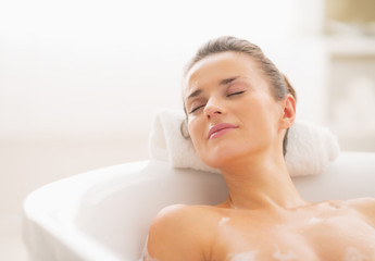 Relaxed young woman in bathtub
